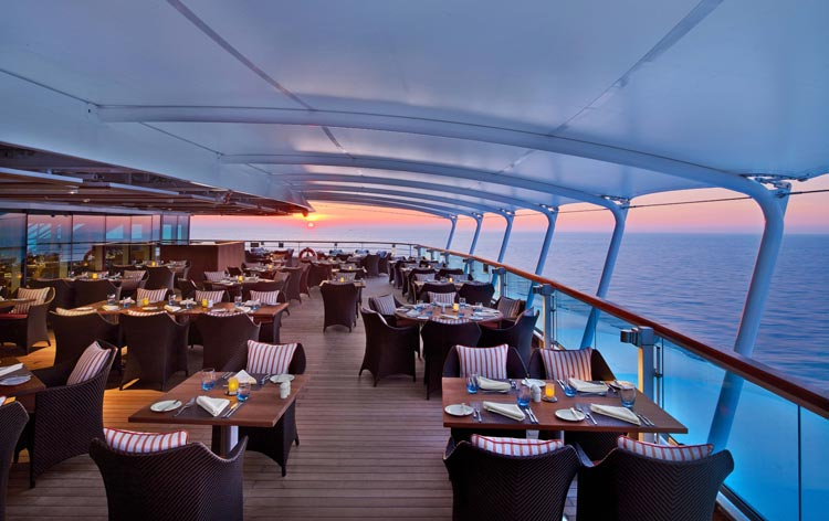Enjoy al fresco dining in The Colonnade, one of the classy dining venues on Seabourn Encore.