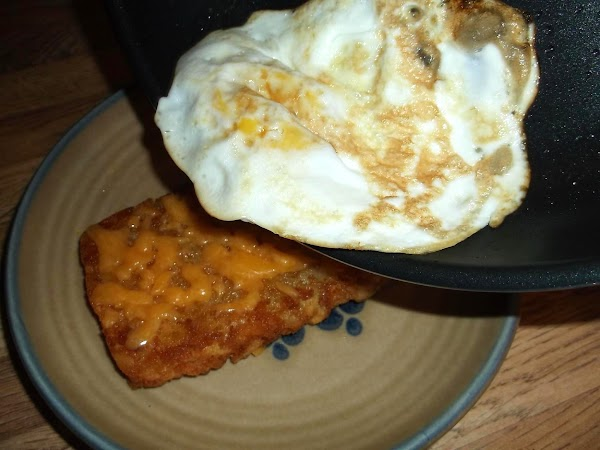 Slide fried egg onto patty; sprinkle with salt and/or pepper to taste.