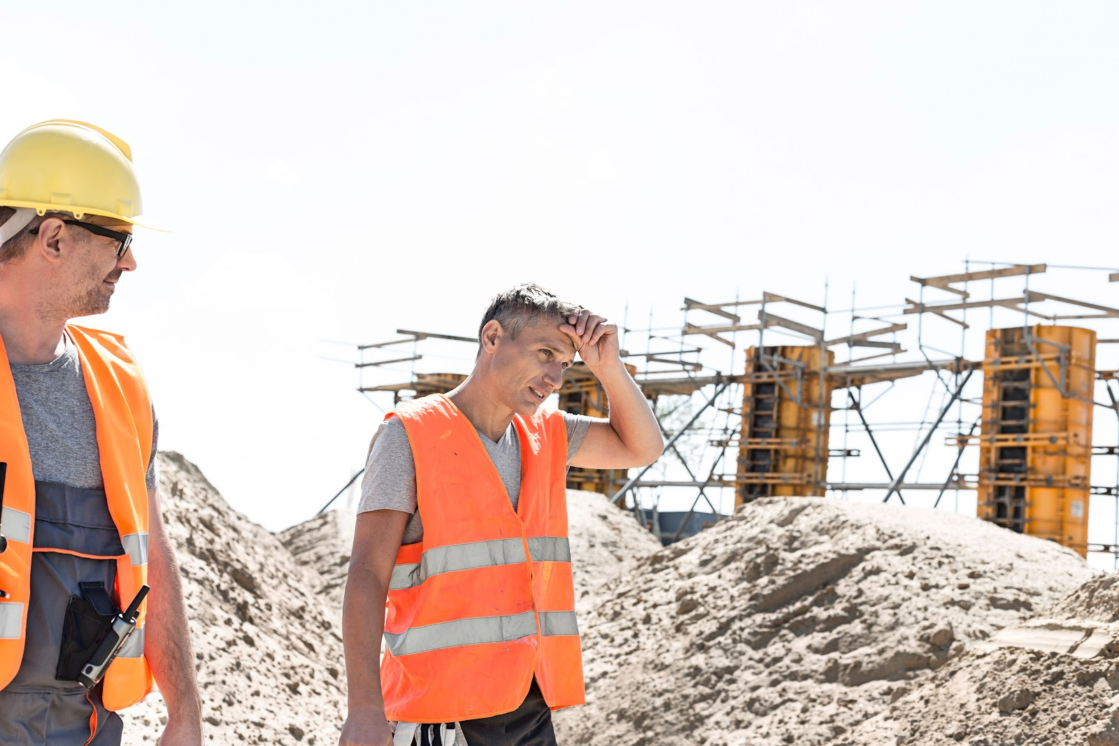 electrolyte imbalance: two construction workers under the heat of the sun