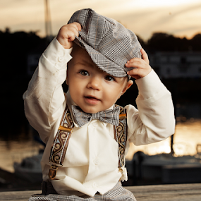 Playing with his hat by Joseph Humphries - Babies & Children Toddlers ( sunset, children, candid, baby, suspenders, toddler, portrait )