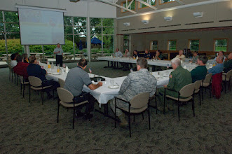 Photo: Officials from municipalities around the Minneapolis –St. Paul metro are briefed by Major General Larry Shellito, Adjutant General of the Minnesota National Guard, during Metro Mayors Day at the 133rd Airlift Wing on August 19, 2010. The Minnesota National Guard units at the Minneapolis-St. Paul International Airport brought local officials on base and on a flight on a military cargo aircraft to demonstrate the capabilities that could be available once authorized for communities. USAF Official Photo by Senior Master Sgt. Mark Moss