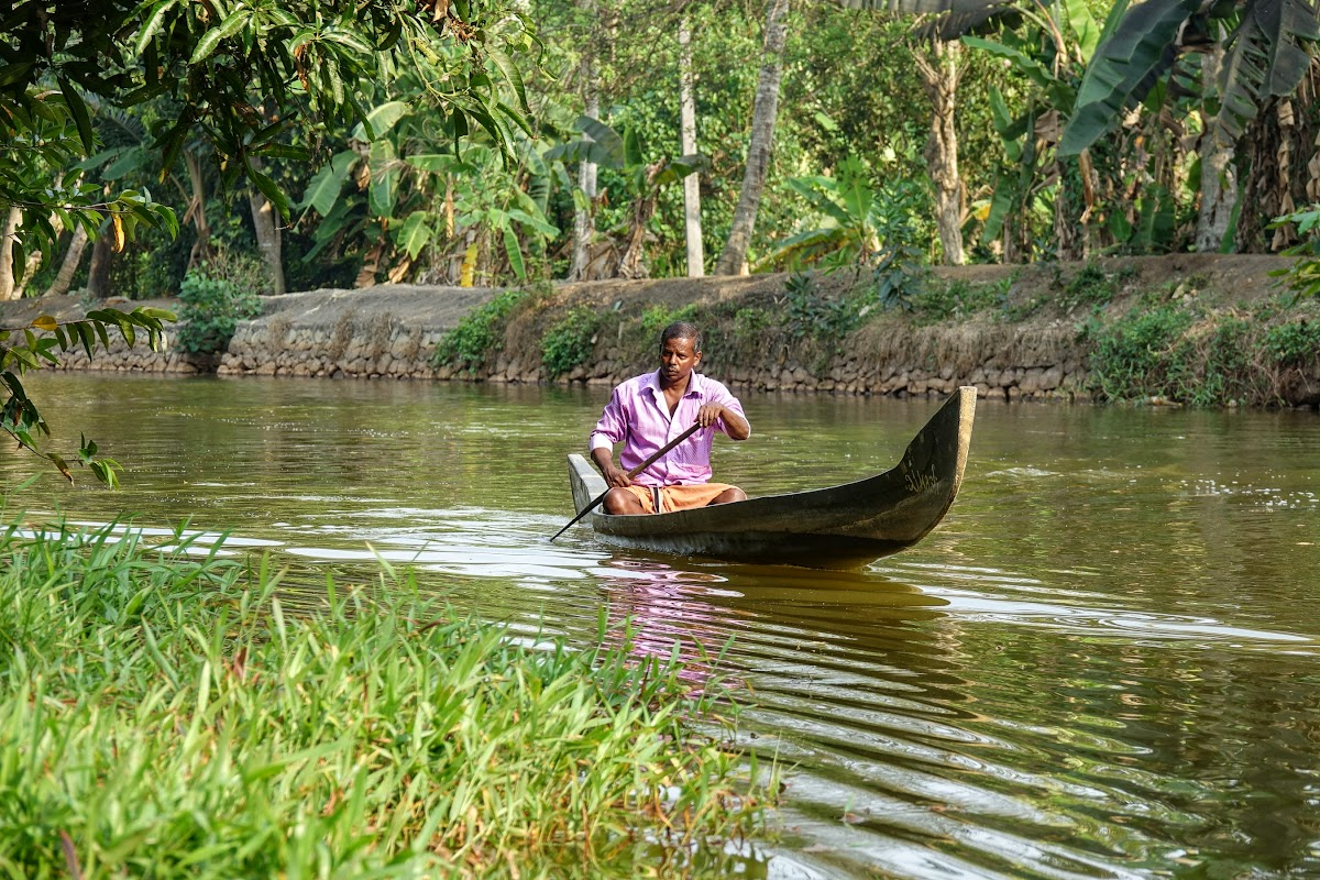 India. Kerala Motorbike Road Trip. Fisherman in Kumarakom Backwaters