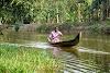 India. Kerala Motorbike Road Trip. Fisherman in Kumarakom Backwaters
