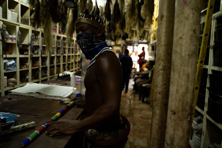 Thando Mahlangu visits a traditional African shop on Bloed Street in Pretoria to do his monthly shopping.