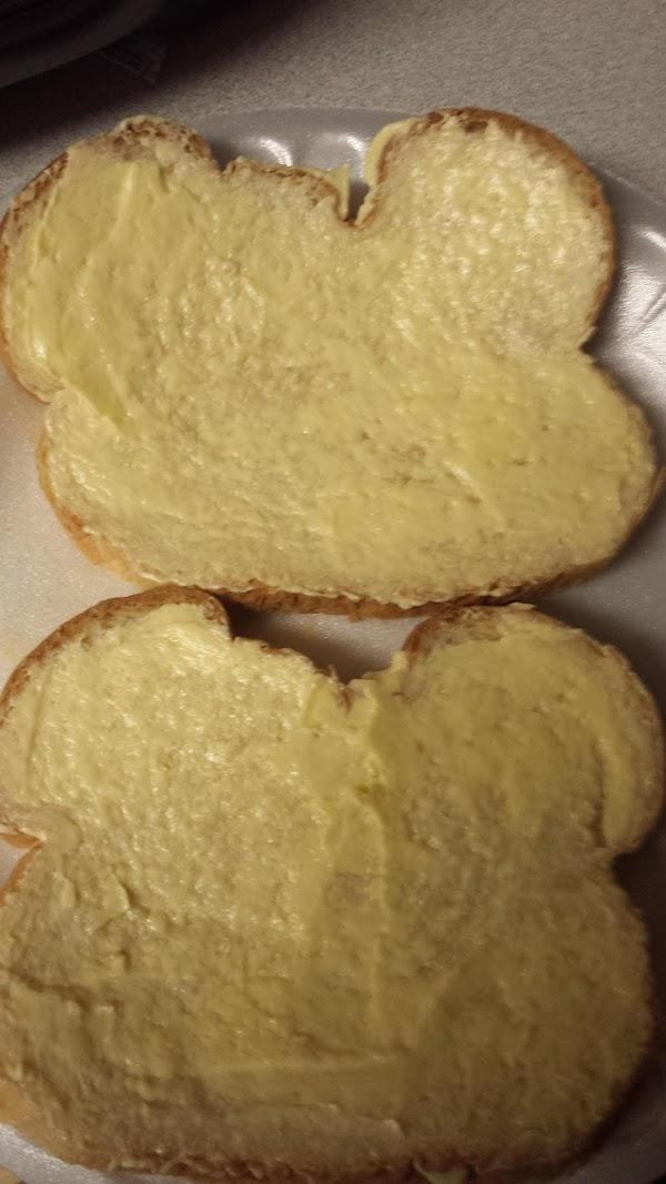 Butter one side of each slice of bread.