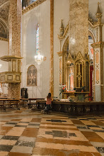 Photo: Gilded neo-Gothic tabernacle (1855) on pillar just beyond entrance to the Cappella dello Spirito Santo, with highly venerated image of the Madonna delle Grazie, attributed to Giannicola di Paolo