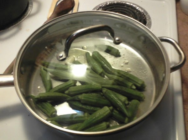 Turn heat to high. Cook for about 4-5 minutes, covered, shaking pan to keep...