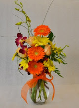 Photo: Gerberas and Orchids $40.00.