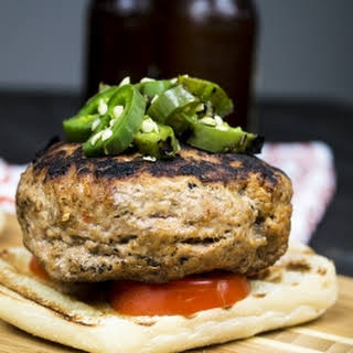 Turkey Burgers Stuffed with Roasted Red Pepper and Goat Cheese, topped with Roasted Jalapeno Peppers.