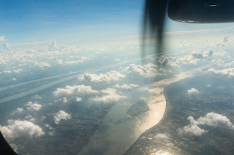 Photo: the Mekong delta, under plane's wingspan