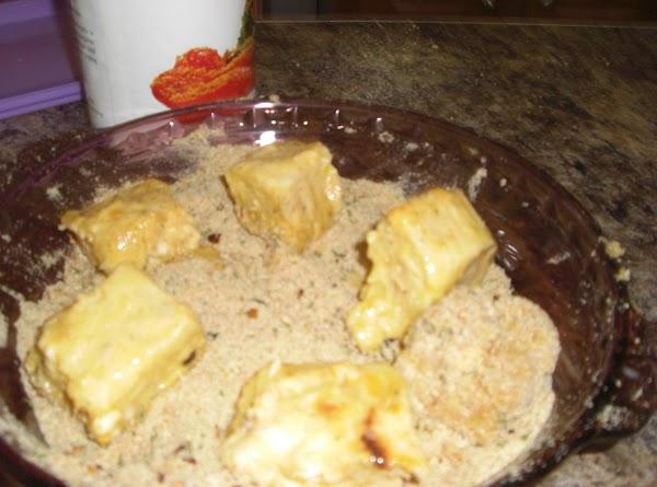 Mix panko bread crumbs with salt, pepper, parsley, cayenne, onion and garlic powder, set...