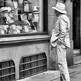 Which hat by Yvonne Katcher - City,  Street & Park  Street Scenes ( jacket, shoes, trousers, white, man, black, hat, pavement )