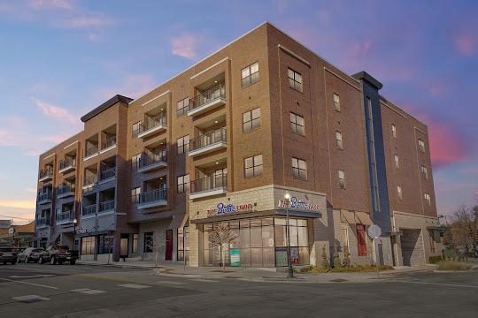 Exterior view of Market Lofts Apartments at dusk
