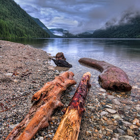 Distant Clouds by James Wheeler - Landscapes Beaches ( clouds, shore, mountains, maple ridged, canada, golden ears provincial park, logs, beach, stones, rocks, british columbia )