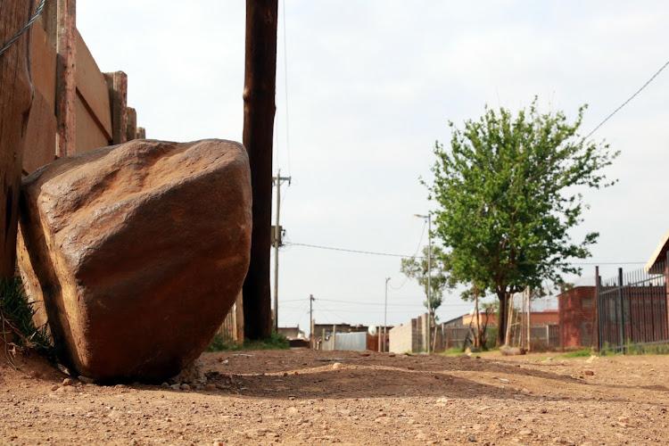 Mpho Makondo's body was found in the shadow of this rock about 12 hours after she went missing in Orange Farm south of Johannesburg.