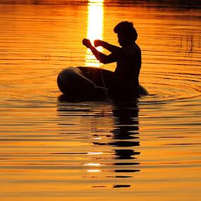 Fishing during the Sunset by Udhay Krishnamurthy - Landscapes Sunsets & Sunrises ( sunset, india )