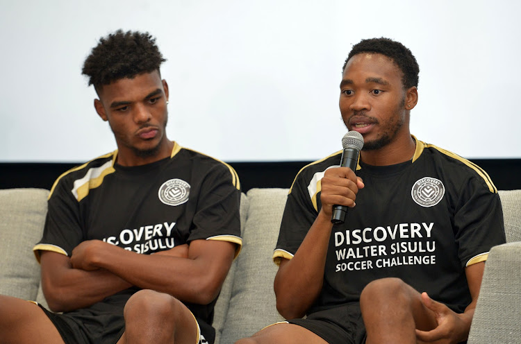 Mamelodi Sundowns midfielder Sibusiso Vilakazi (R) speaks alongside Orlando Pirates' AC Monaco-bound striker Lyle Foster (L) during the media launch of the 16th edition of the annual Discovery Walter Sisulu Soccer Challenge at Discovery Place in Sandton on Tuesday November 27 2018. Both players played in the tournament in their formative years as professional footballers.