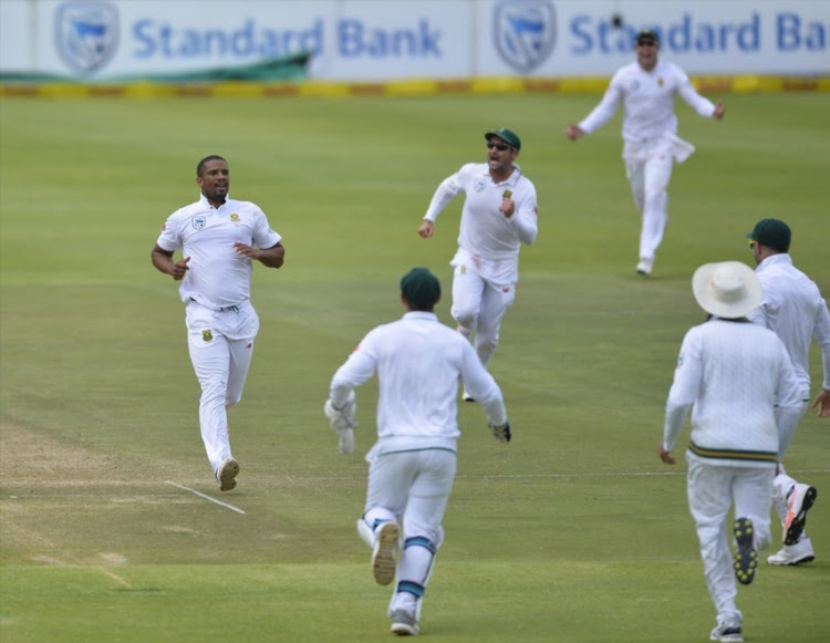 Vernon Philander of South Africa and team mates celebrate the wicket of Virat Kohli (capt) of India during day 4 of the 1st Sunfoil Test match between South Africa and India at PPC Newlands on January 08, 2018 in Cape Town.
