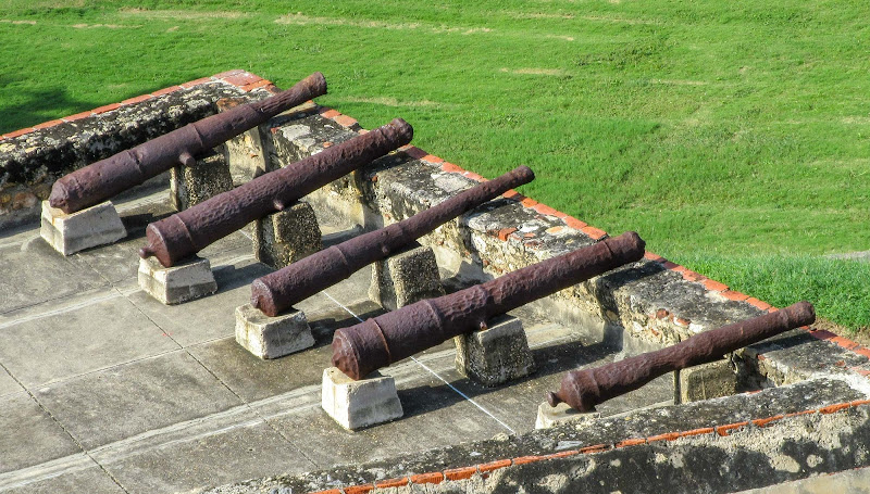Cannons atop a battlement on Castillo San Felipe de Barajas in Cartagena, Colombia.