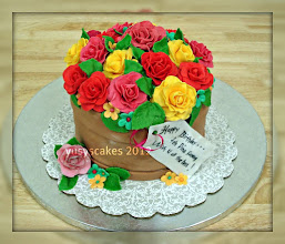 Photo: EDITOR'S CHOICE 1/19/2012  Flowers Pot Cake by Y u s y s C a k e s  View cake details here: http://cakesdecor.com/cakes/5109 View all cakes by YusysCakes: http://cakesdecor.com/YusysCakes/cakes