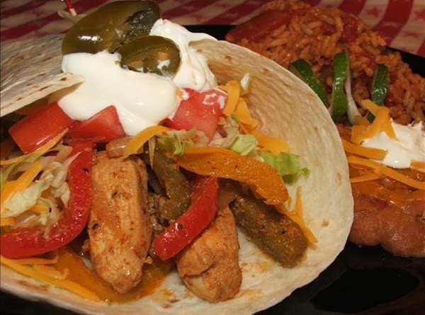 Put cut up chicken, peppers and onion in large bowl or ziploc baggie. Mix...