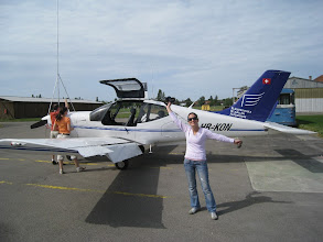 Photo: I'm checking the oil and Yana is enjoying the weather http://www.swiss-flight.net