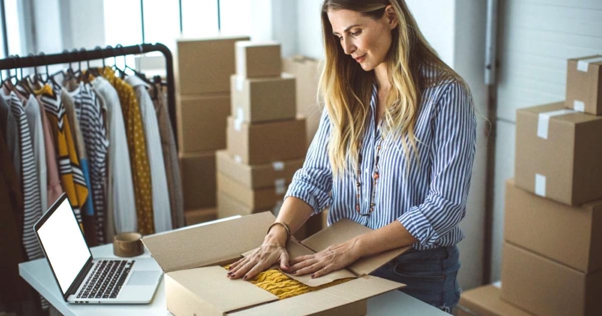 women packing box for ecommerce order