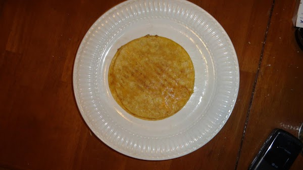 Buttered corn tortillas that have been heated to soften in skillet
