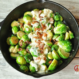 Skillet Roasted Bacon Brussels Sprouts with Garlic Parmesan Cream Sauce.