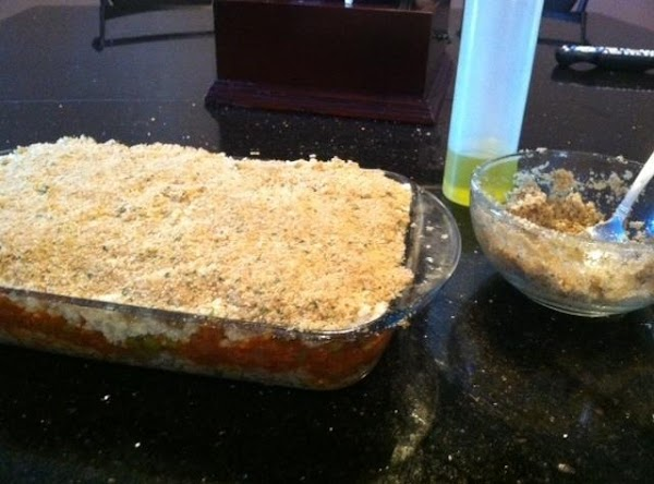 IN A MEDIUM SIZED BOWL MIX TOGETHER BREADCRUMBS, OLIVE OIL (U MITE NEED MORE...MIXTURE...