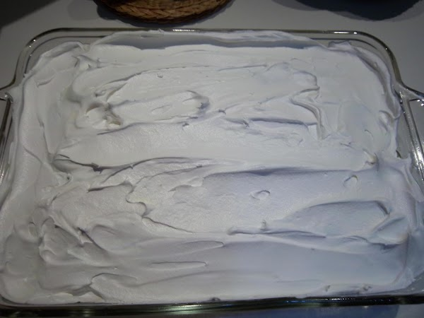 SPREAD THE COOL WHIP ON TOP OF THE LEMON PIE FILLING. REFRIGERATE THE CAKE....