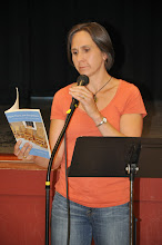 Photo: Cora Goss-Grubbs, one of RASP's founders, reads her poetry from the first-ever RASP poetry anthology.