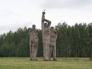 """Photo: An hour out of town is Salaspils, a concentration camp run by the Nazis where many died.  It is now a memorial park with no buildings. This statue is called """"Solidarity"""". I loved the stork perched on the fist."""