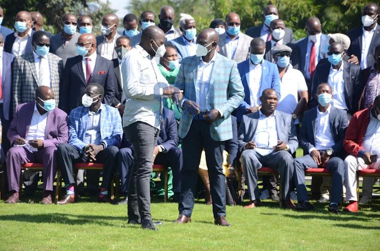 Deputy President William Ruto with Tangatanga MPs at his Karen home on December 2.