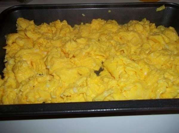 In a skillet, partially cook the eggs, stirring to scramble for approximately 2 to...