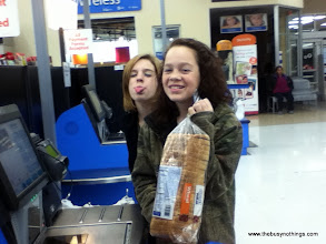 Photo: The girls LOVE doing the self check out!