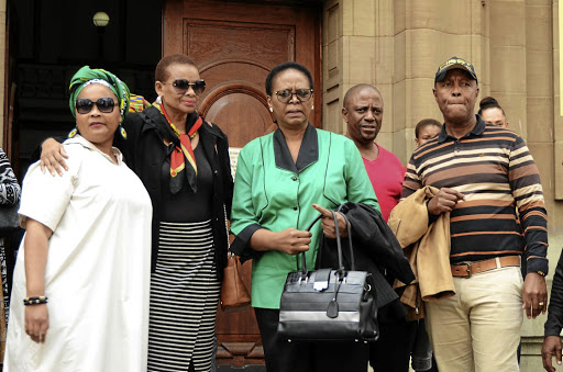 Karabo Mokoena's family with MEC of social development Nandi Mayathula-Khoza outside the Johannesburg High Court during the recess of the case proceedings. / PMduduzi Ndzingi