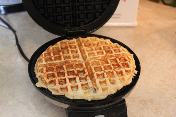 Heat waffle iron, spray, and pour in batter to fill. Close and bake until...
