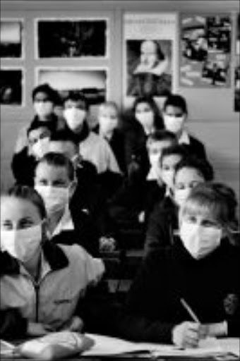 A posed photograph of learners of Kempton Park high school with masks to avoid the risk of getting Swine Flu after a few learners of the school contracted the disease Pic. THYS DULLAART.