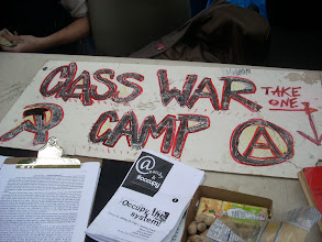 """Photo: Occupy Wall Street; """"Class War Camp"""" sign with communist symbol; photo by Bob Glass; posted with permission by Ari Armstrong."""