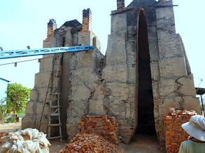 Photo: The bricks are put inside the kiln and the opening is mudded up for the heating process which takes five days.
