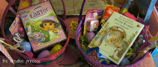 Photo: The Easter Bunny decided to include a DVD for each.  The tray in the back was full of eggs we dyed the night before Easter.  The Easter Bunny decided to hide those for the girls to find on Easter morning.