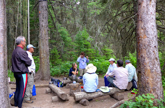 Photo: Kootenai Lakes food prep area: Everyone eats and keeps their food in a common area that is 50-100 ft. from any campsite.  Each campground has 2-4 campsites.  On our first night we enjoyed visiting with a young couple from WI and a family from CA.