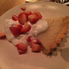 GF lemon tart with coconut whipped cream and fresh strawberries. Photo by Cg.