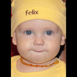 Felix by Jennifer  Loper  - Babies & Children Child Portraits ( felix, yellow, hat, amber beads, blue eyes,  )