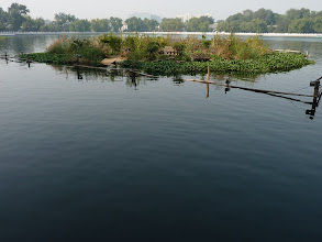 Photo: Beijing - Houhai lake and small island for ducks with house and bridge