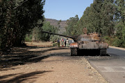 FILE PHOTO: A burned tank stands near the town of Adwa, Tigray region, Ethiopia, March 18, 2021.