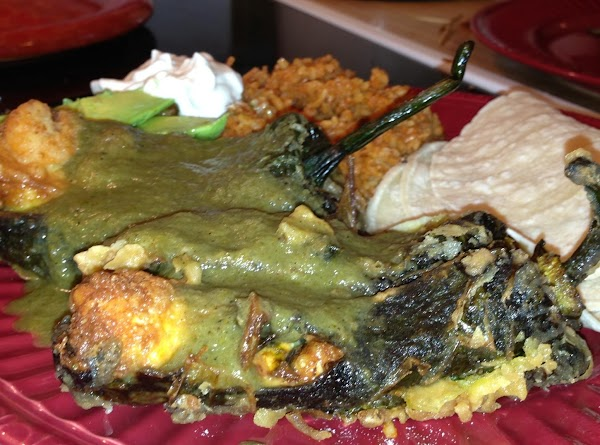 Plate chile's immediately and cover with salsa. Serve with Rice and beans if you...
