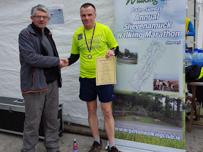 Photo: Rody Tierney congratulates David Toomey (Listowel) on his 50th Marathon in a time of 3 hours 44 mins. The 2016 Slievenamuck Marathon in Co. Tipperary took place on March 20th.