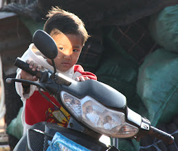 Photo: Day 310 - Small Boy on Daddy's Bike (Laos)